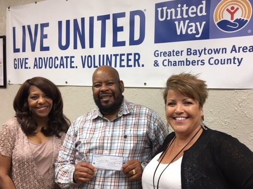 One family who was returned home with Traci Dillard, Resource Development Dir